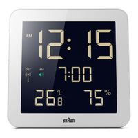 WHITE DIGITAL WALL/TABLE CLOCK WITH DAY/DATE/TEMPERATURE BY BRAUN