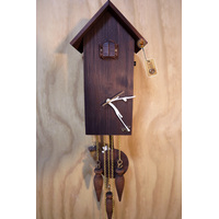 MODERN BATTERY WALNUT WITH BIRD FEEDER AND SWINGING CAT ON PENDULUM 29CM CUCKOO CLOCK BY HETTICH